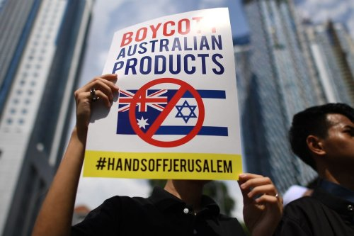 Demonstrators rally outside the Australian embassy in Kuala Lumpur following Australia's decision to recognise Jerusalem as the capital of Israel [MOHD RASFAN/AFP/Getty Images]