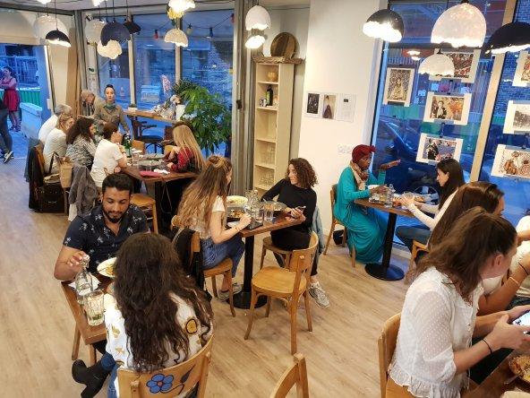 Customers enjoying Palestinian dishes at ARDI - ARDI Facebook