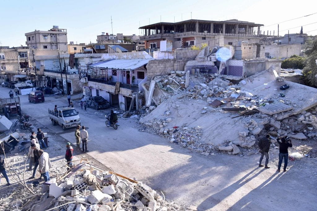 People inspecting damaged buildings following a reportedly Israeli air strike on the Syrian village of Beit Saber, southwest of the capital Damascus on 20 November, 2019 [SANA/AFP via Getty Images]