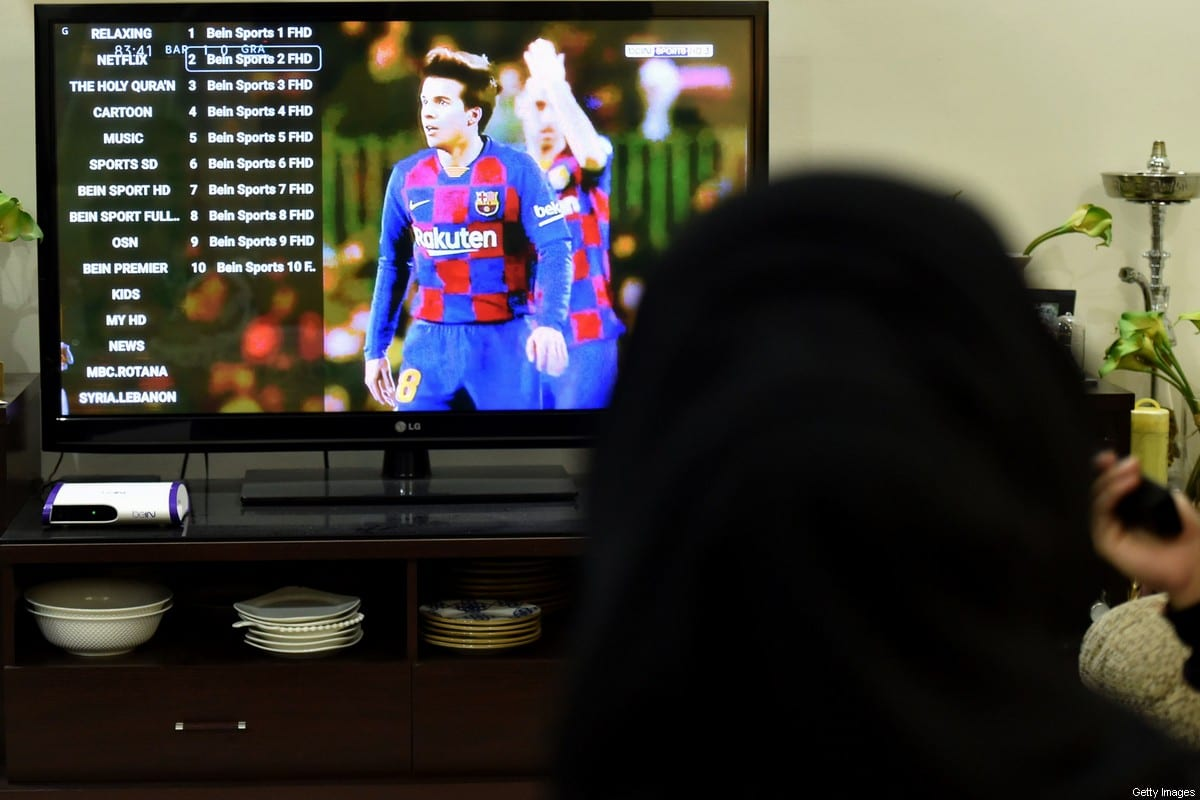 A picture taken January 20, 2020, shows family members watching Qatar's beIN sport channel at their home in the Saudi capital Riyadh. [FAYEZ NURELDINE/AFP via Getty Images]