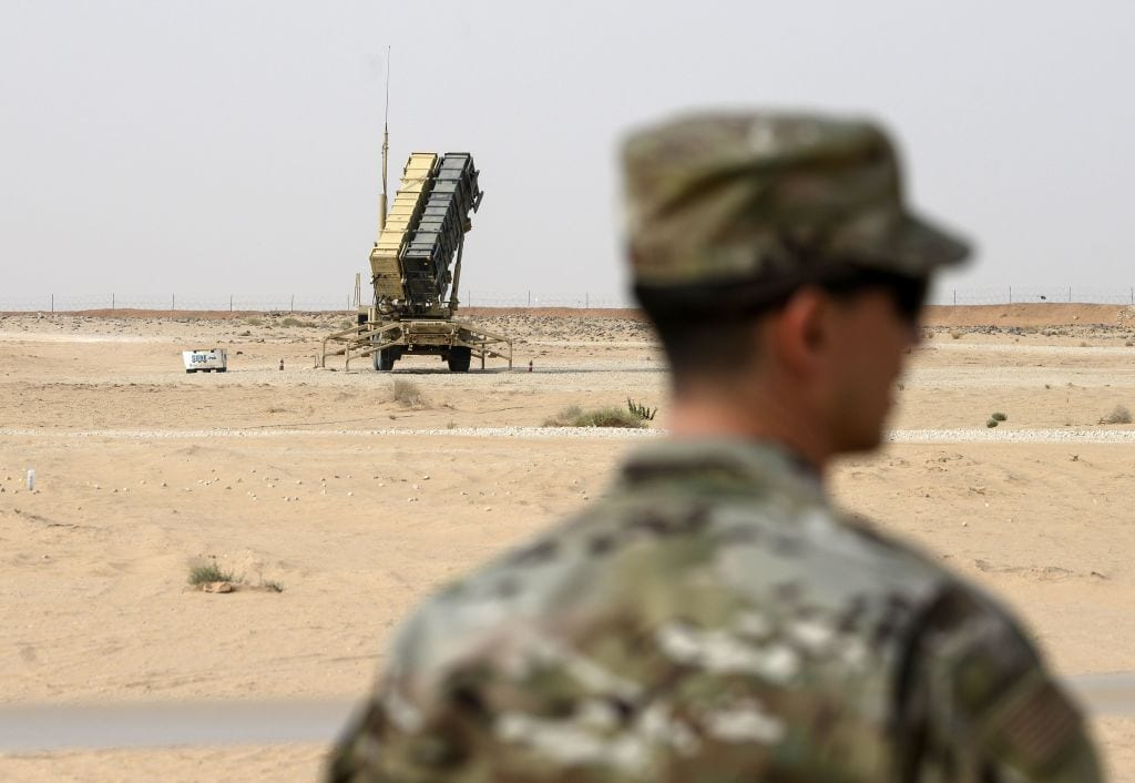 A member of the US Airforce looks on near a Patriot missile battery at the Prince Sultan air base in Al-Kharj, in central Saudi Arabia on 20 February, 2020 [ANDREW CABALLERO-REYNOLDS/POOL/AFP via Getty Images]