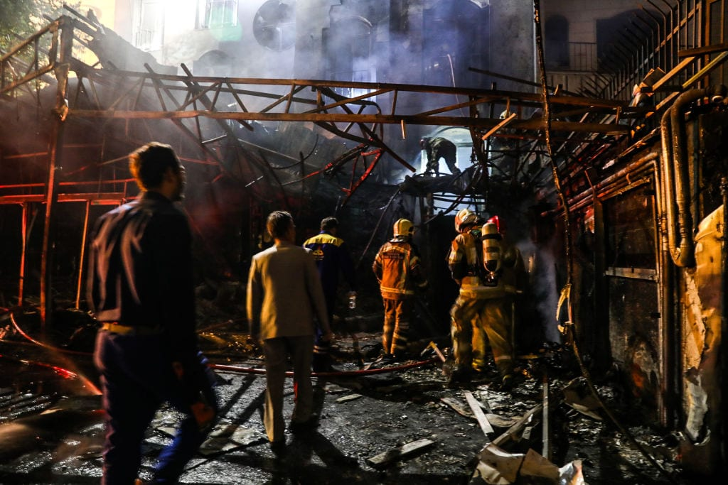 First responders gather at the scene of an explosion at the Sina At'har health centre in the north of Iran's capital Tehran northern Tehran on 30 June, 2020 [AMIR KHOLOUSI/ISNA/AFP via Getty Images]