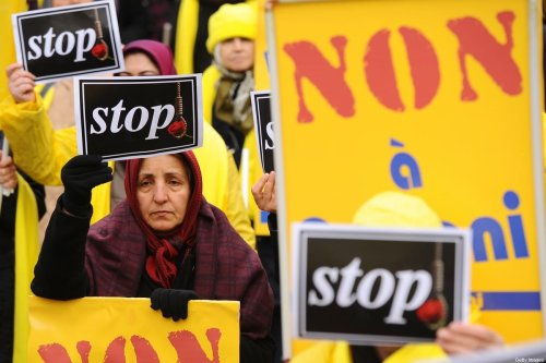 PARIS, FRANCE - JANUARY 28: Iranians, supporters of the National Council Resistance of Iran (NCRI), protest on January 28, 2016 in Paris, France. [Frederic Stevens/Getty Images]