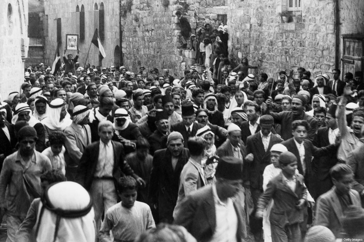 A picture dated before 1937 during the British Mandate in Palestine shows Arabs demonstrating in the Old City of Jerusalem against the Jewish immigration to Palestine. [AFP via Getty Images]