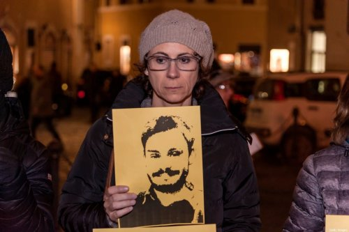 People take part in a torchlight procession organized by Amnesty International to commemorate the second anniversary of the death of Giulio Regeni on January 25, 2018 in Rome, Italy [Stefano Montesi/Corbis/Getty Images]