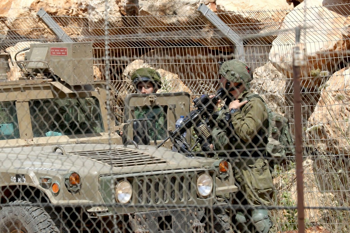 Israeli troops are seen at the Lebanon border on 8 June 2018 [MAHMOUD ZAYYAT/AFP/Getty Images]