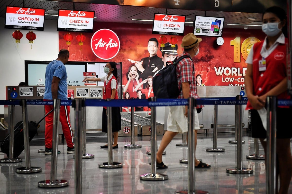 Passengers check in at U-Tapao Airport in Rayong, Thailand on 4 February 2020 [LILLIAN SUWANRUMPHA/AFP/Getty Images]