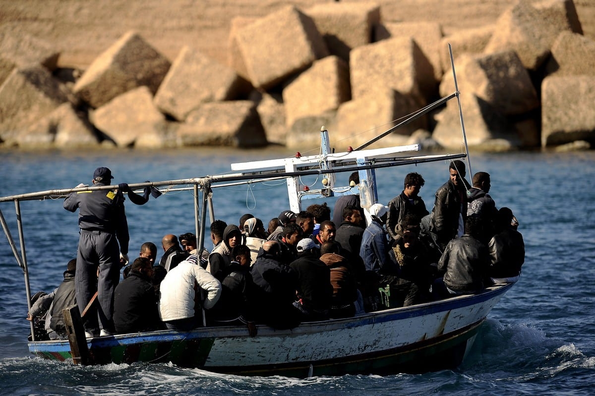 Migrants from Tunisia arrive to an Italian island 10 April 2017 [FILIPPO MONTEFORTE/AFP via Getty Images]