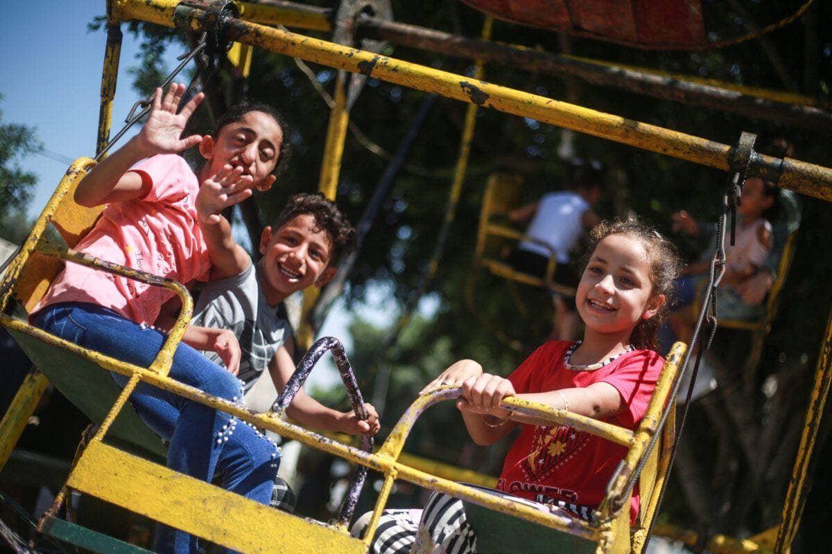 Palestinian children enjoy the Eid al-Adha festivities at a playground in Rafah, Gaza on August 01, 2020 [Mustafa M. B. Hassouna / Anadolu Agency]