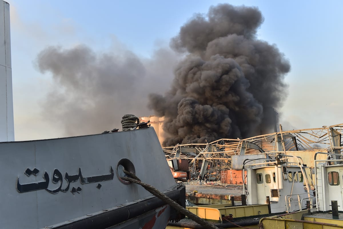 Smoke rises after a fire at a warehouse with explosives at the Port of Beirut led to massive blasts in Beirut, Lebanon on 4 August 2020. [Houssam Shbaro - Anadolu Agency]