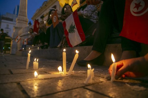 Candles lit during a demonstration in support of the Lebanese people following an explosion in the port of Beirut, on 6 August 2020 [Yassine Gaidi/Anadolu Agency]