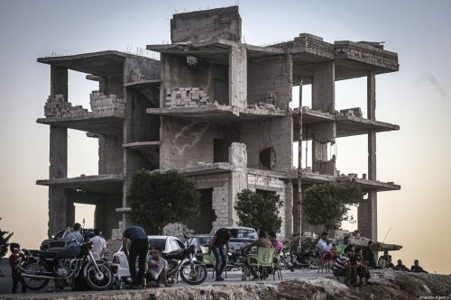 Syrians continue their lives among buildings damaged within the ongoing civil war in Idlib, Syria on August 14, 2020 [Muhammed Said/Anadolu Agency]