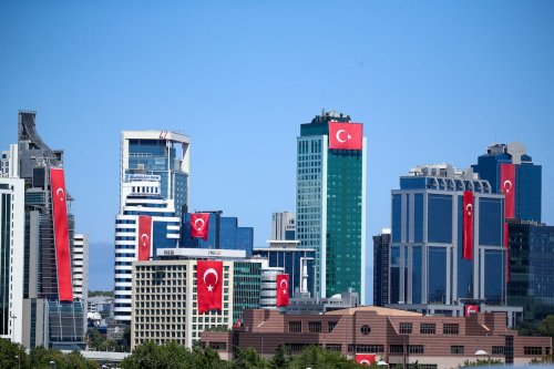 Turkish national flags are hung on skyscrapers in Maslak district ahead of the Anniversary of Turkey's Victory Day, celebrated on 30th of August, in Istanbul, Turkey on August 29, 2020 [Muhammed Enes Yıldırım / Anadolu Agency]