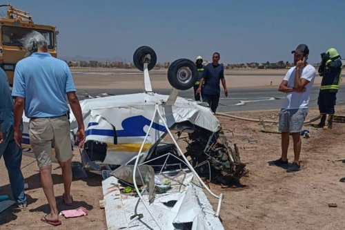 Egyptian investigators inspect a light aircraft which crashed on landing at Gouna airport in Egypt on 6 August 2020 [AFP/Getty Images]