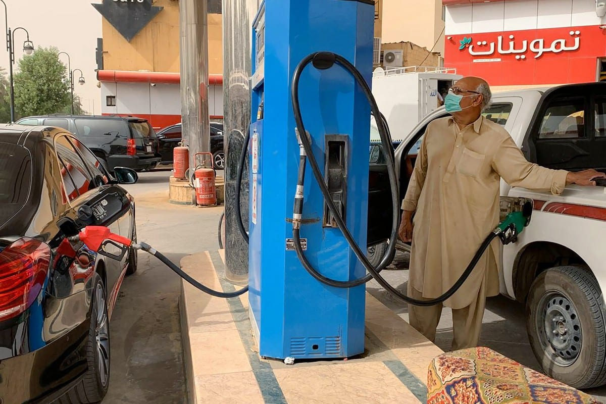 A man refills his car at a gas station in the Saudi capital Riyadh on 11 May 2020 [RANIA SANJAR/AFP/Getty Images]
