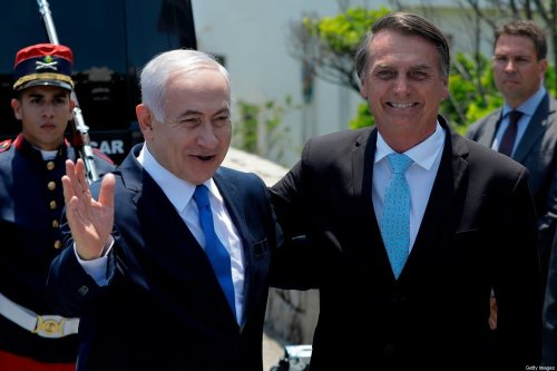 Israel's Prime Minister Benjamin Netanyahu (L) and Brazil's President Jair Bolsonaro in Brazil, on 28 December 2018 [LEO CORREA/AFP/Getty Images]