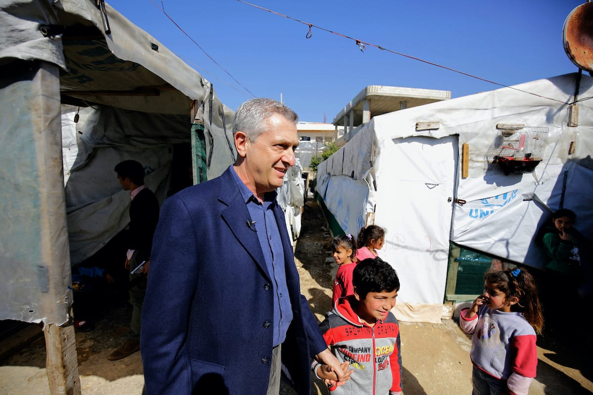 Filippo Grandi, the United Nations High Commissioner for Refugees, meets with Syrian refugee children at a camp in the village of Mhammara in the northern Lebanese Akkar region on 9 March 2019. [IBRAHIM CHALHOUB/AFP via Getty Images]