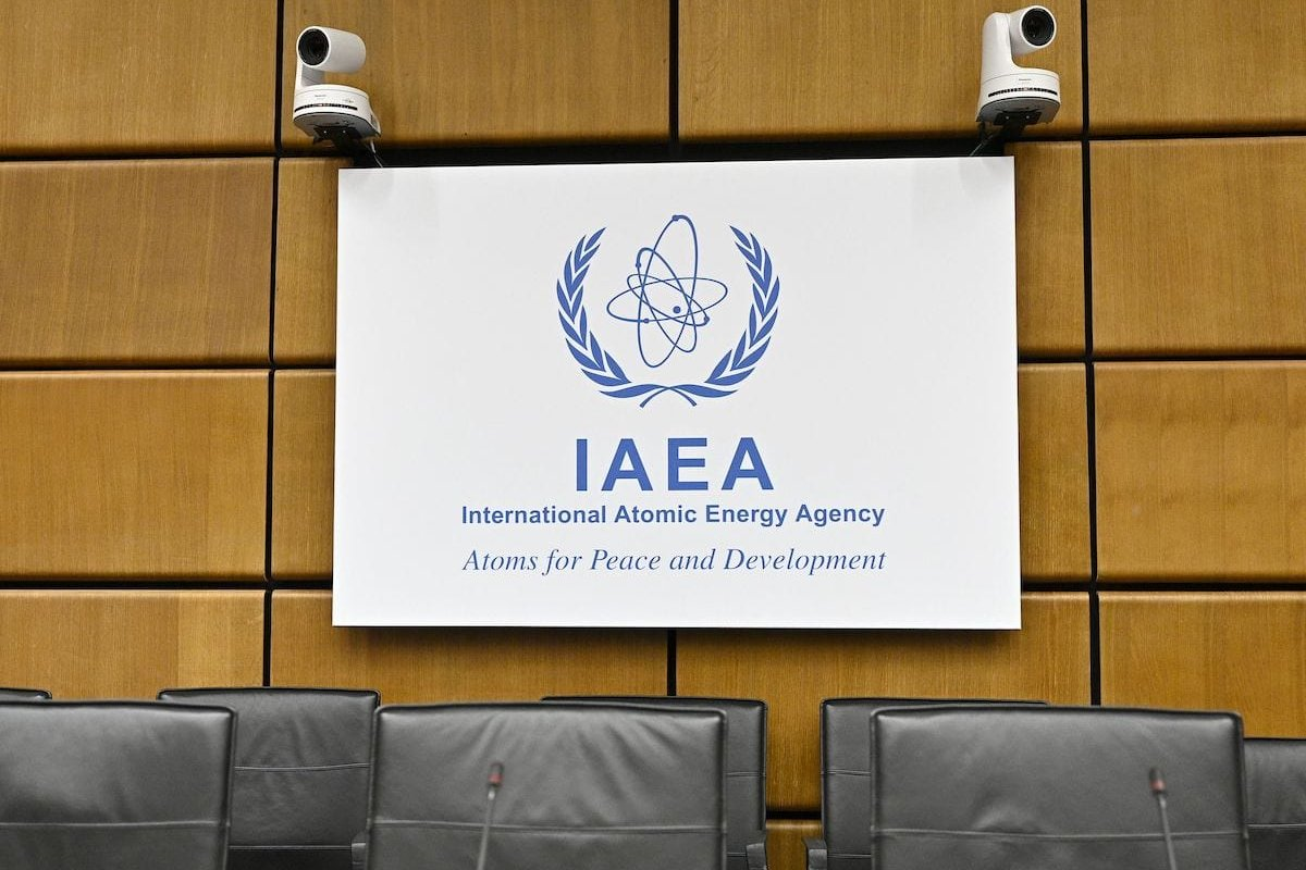 Empty chairs are seen in front of the logo of the International Atomic Energy Agency (IAEA) prior to a meeting in Vienna on 1 August 2019. [HANS PUNZ/AFP via Getty Images]