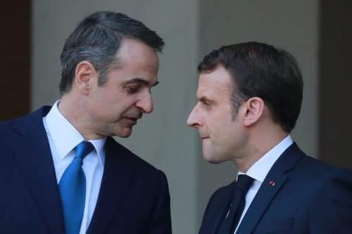 French President Emmanuel Macron (R) and Greek Prime Minister Kyriakos Mitsotakis speak following their meeting at the Elysee Palace in Paris on 29 January 2020. [LUDOVIC MARIN/AFP via Getty Images]