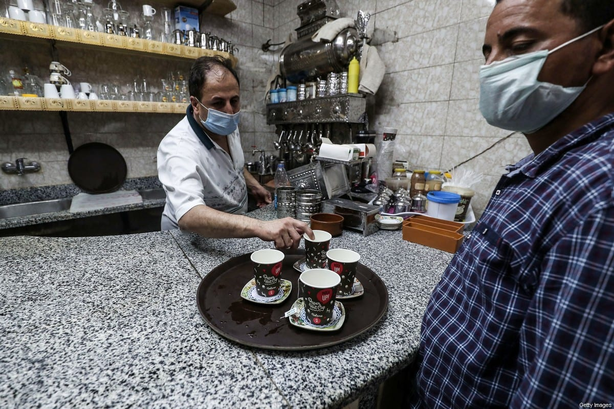 A worker prepares an order at a cafe in the Egyptian capital Cairo on June 27, 2020 [MOHAMED EL-SHAHED/AFP via Getty Images]