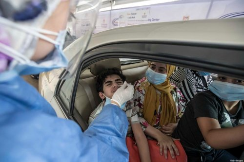 Egyptians get tested for Covid-19 at a drive-through coronavirus-testing centre at the Ain Shams University in Cairo on 29 June 2020. [KHALED DESOUKI/AFP via Getty Images]