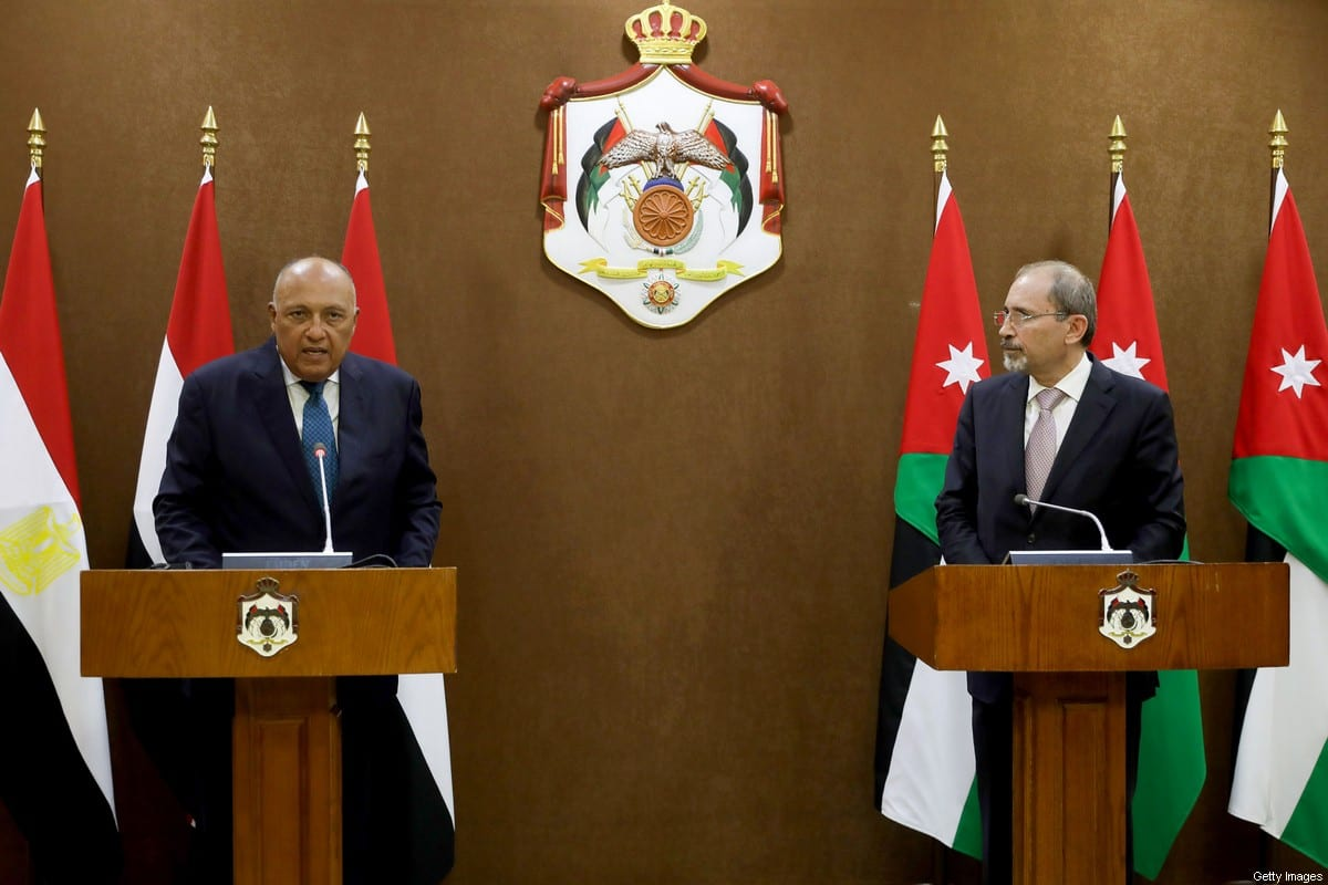 Jordan's Foreign Minister Ayman Safadi (R) listens to Egypt's Foreign Minister Sameh Shoukry during a press conference in the capital Amman on July 19, 2020 [MUHAMMAD HAMED/POOL/AFP via Getty Images]