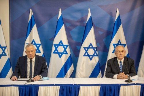 Israeli Prime Minister Benjamin Netanyahu (R) and alternate Prime Minister and Defence Minister Benny Gantz (L) issue a statement at the Israeli Defence Ministry in Tel Aviv on July 27, 2020 [TAL SHAHAR/POOL/AFP via Getty Images]