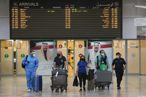 Travellers arrive at Kuwait international Airport, in Farwaniya, about 15kms south of Kuwait City, on 1 August 2020. [YASSER AL-ZAYYAT/AFP via Getty Images]