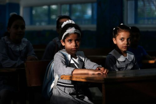 Palestinian students attend class at a school run by the United Nations Relief and Works Agency (UNRWA) in Gaza on 8 August 2020 [MAHMUD HAMS/AFP/Getty Images]