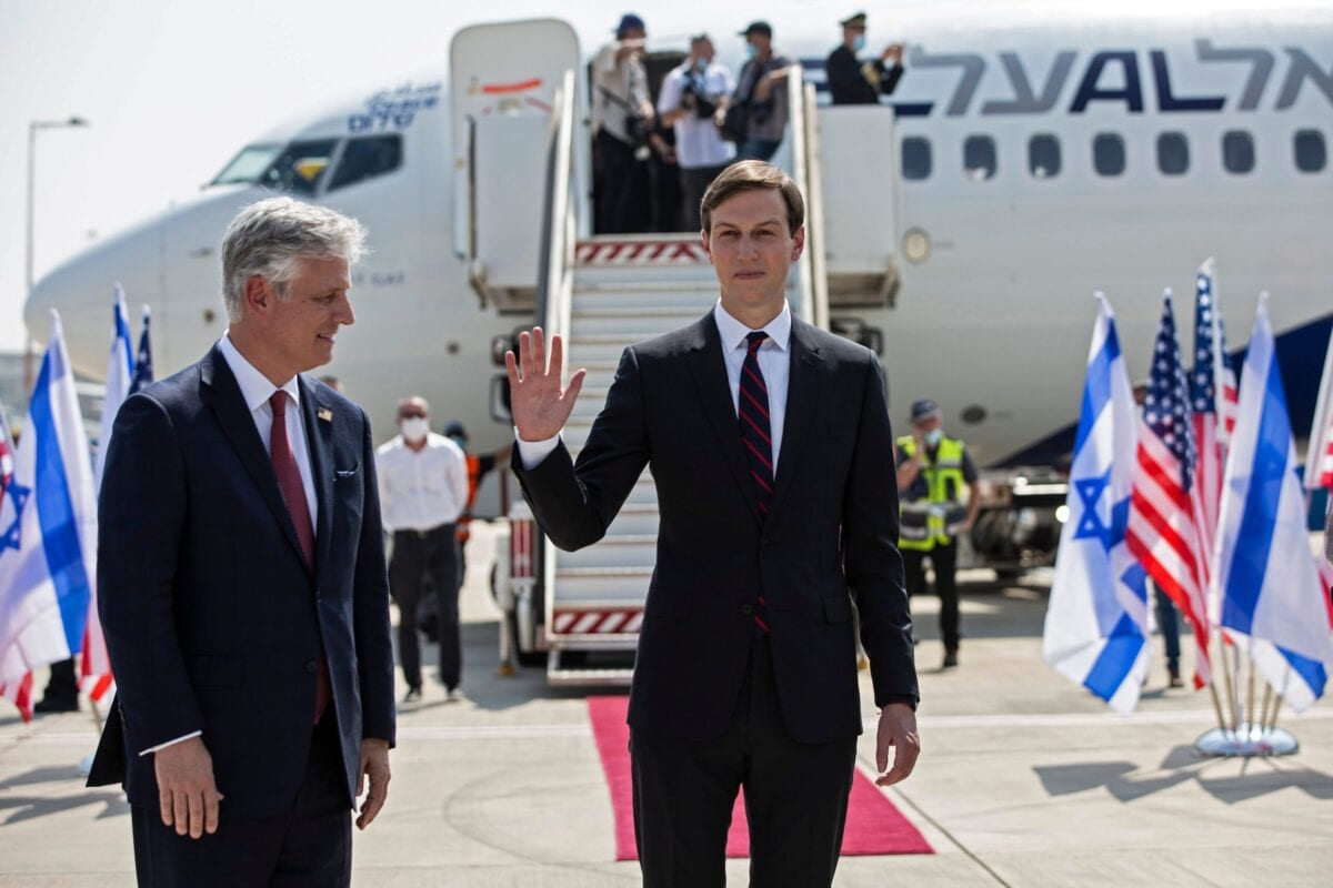 US Presidential Adviser Jared Kushner (R) waves as he stands next to US National Security Adviser Robert OBrien ahead of boarding the El Al's flight LY971, which will carry an Israeli-American delegation from Tel Aviv to Abu Dhabi, at the Ben Gurion Airport near Tel Aviv on August 31, 2020 [HEIDI LEVINE/AFP via Getty Images]