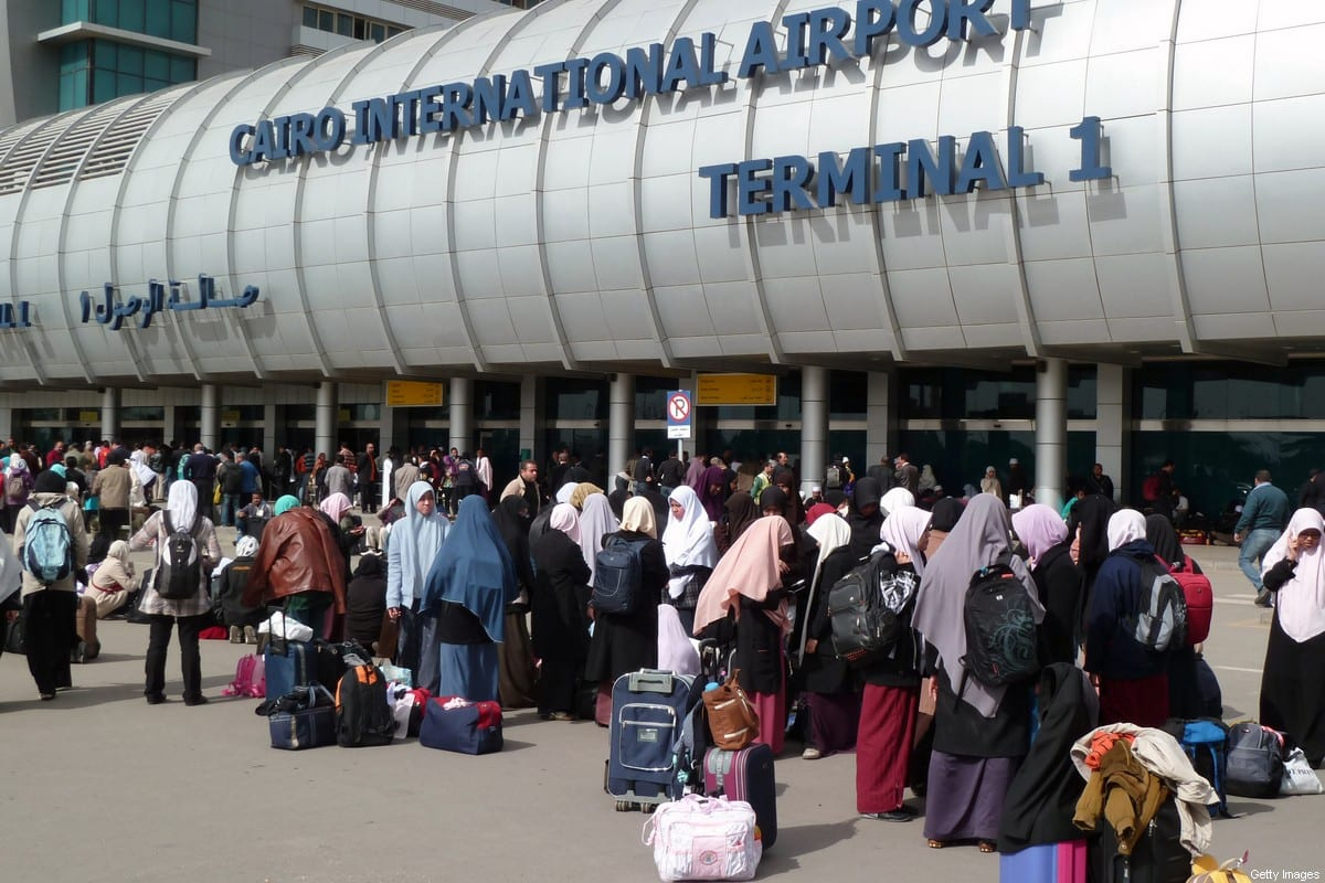 People crowd the entrance to Cairo's International Airport on February 3, 2011 [MICHEL MOUTOT/AFP/GettyImages]