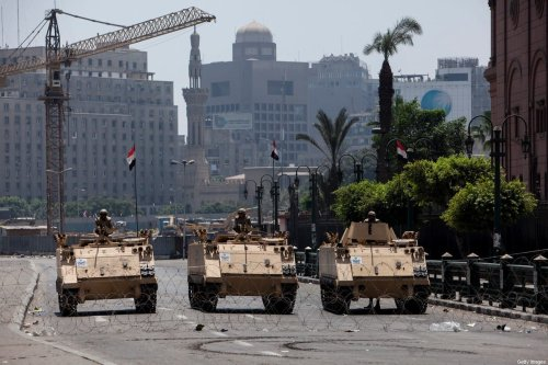 Egyptian military vehicles stand guard in Cairo, Egypt, 16 August 2013 [Ed Giles/Getty Images]