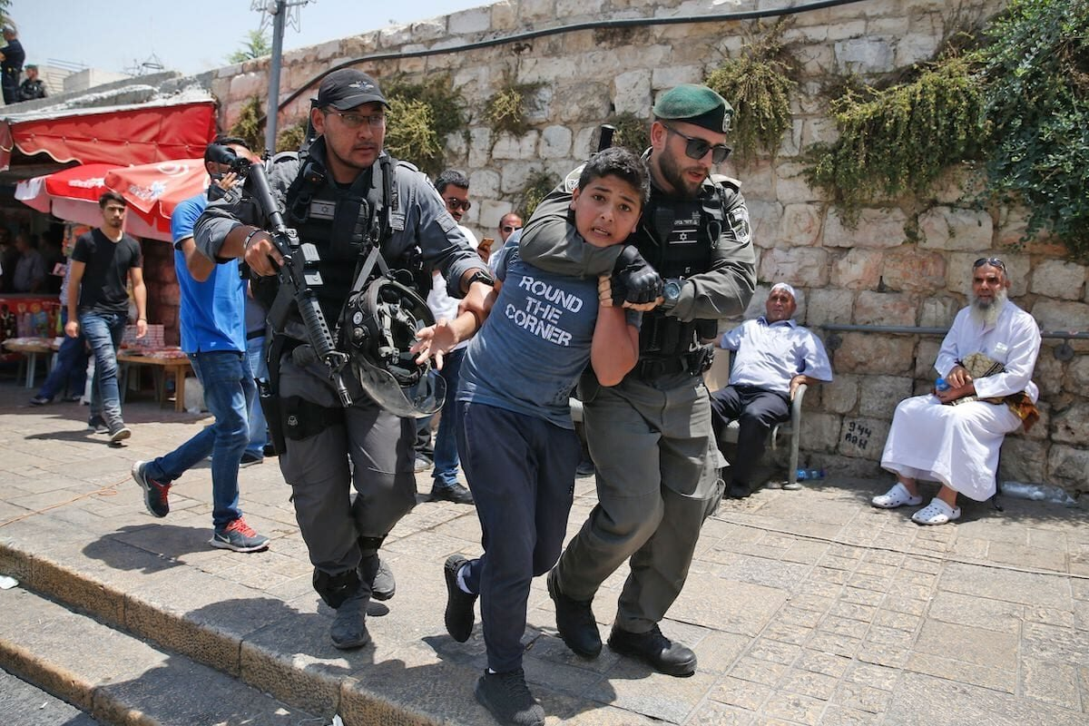 Israeli border guards detain a Palestinian youth during a demonstration outside the Lions Gate, a main entrance to Al-Aqsa mosque compound, due to newly-implemented security measures by Israeli authorities which include metal detectors and cameras, in Jerusalem's Old City on July 17, 2017 [AHMAD GHARABLI/AFP via Getty Images]