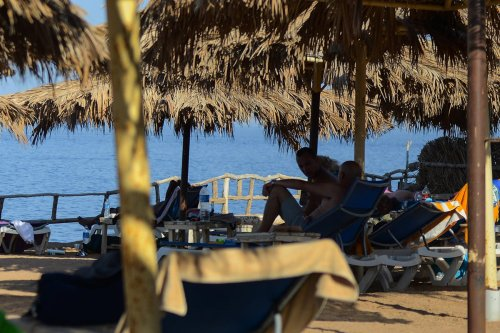 Tourists are seen in the Egyptian Red Sea resort of Sharm el-Sheikh on August 7, 2017. Saudi Arabian billionaire Prince Alwaleed bin Talal is to invest more than $800 million in hotels in Egypt, the investment ministry in Cairo said. The announcement came after parliament in May adopted a new law aimed at attracting foreign investment as the authorities seek to reinvigorate the North African country's struggling economy. / AFP PHOTO / MOHAMED EL-SHAHED (Photo credit should read MOHAMED EL-SHAHED/AFP via Getty Images)