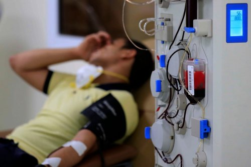 An Egyptian man who recovered from Covid-19 donates blood at a hospital in Cairo, Egypt on 22 July 2020 [KHALED DESOUKI/AFP/Getty Images)