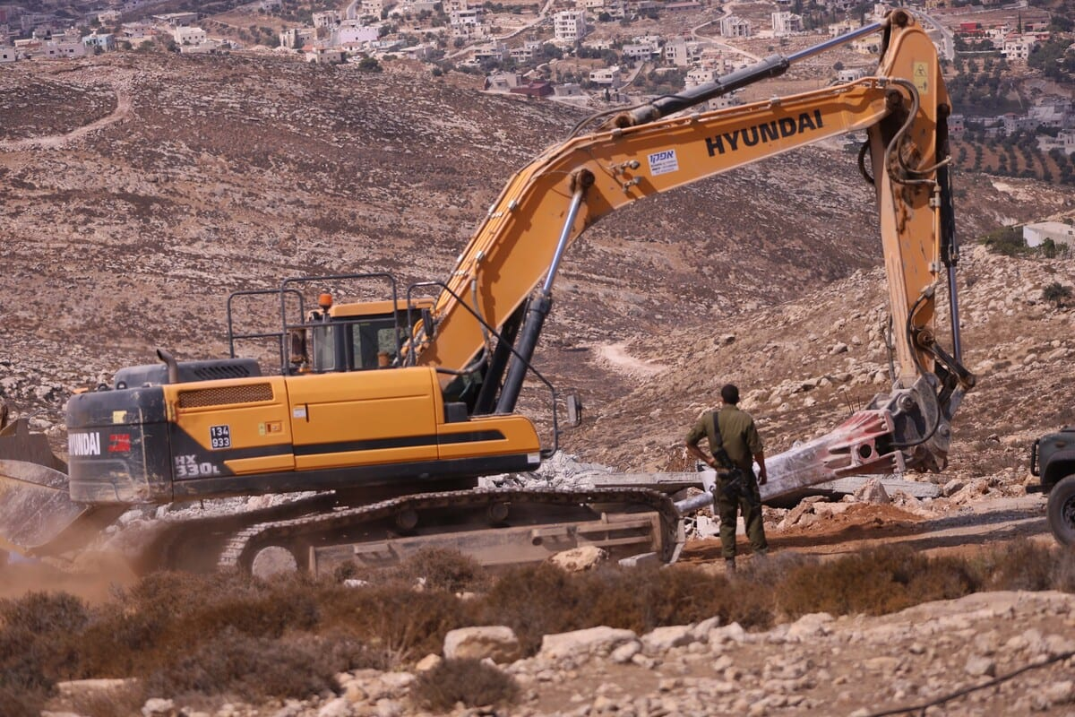 Israeli excavators demolish some of constructions belonging to Palestinians for allegedly being unauthorized at Dora district in Hebron, West Bank on September 23, 2020 [Mamoun Wazwaz - Anadolu Agency]