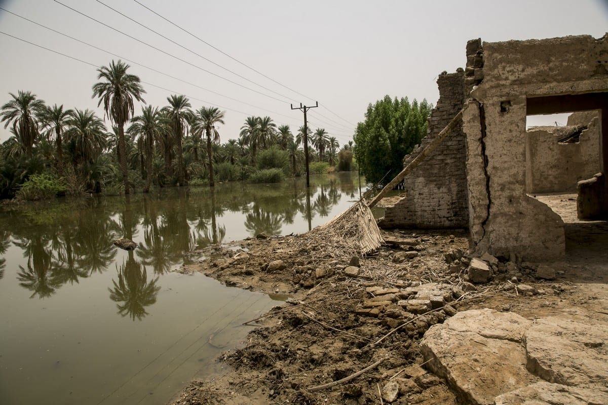 A general view of a destroyed building is seen near a submerged area after flash floods hit Merove town of Khartoum, Sudan on 13 September 2020. [Mahmoud Hjaj - Anadolu Agency]