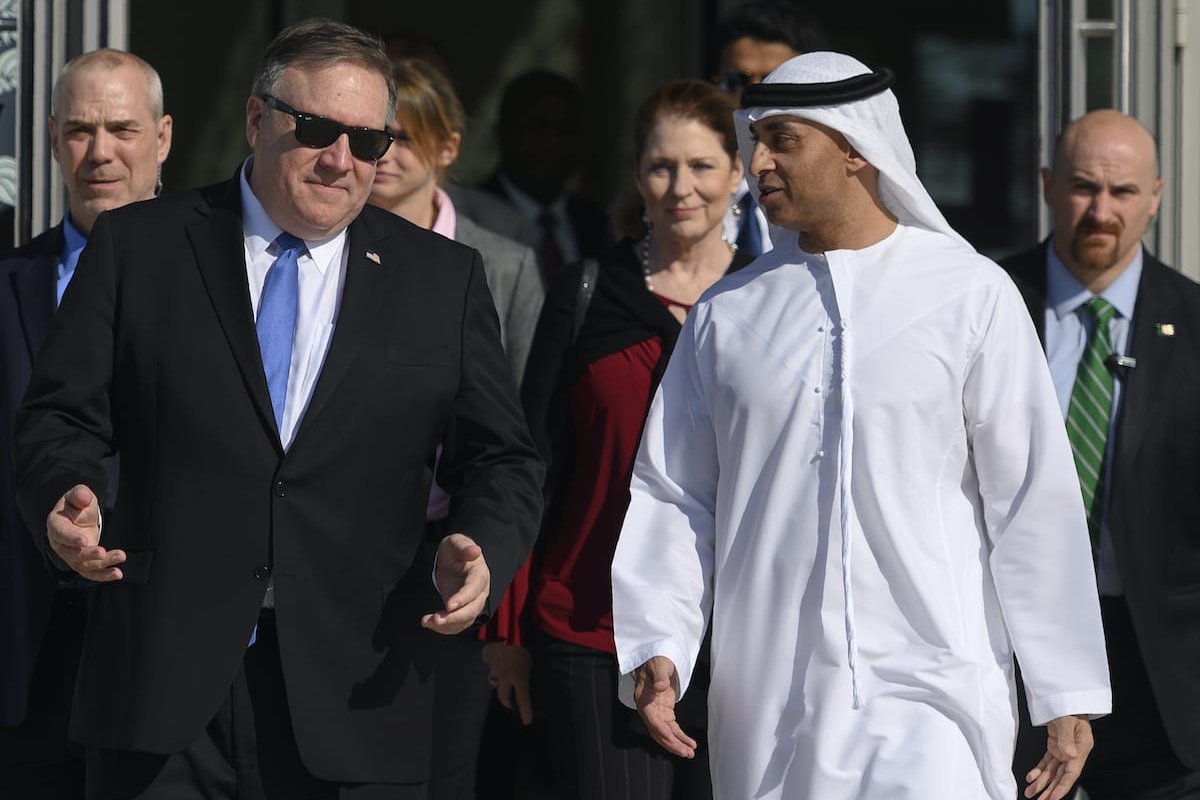 US Secretary of State Mike Pompeo (L) speaks with the Emirati Ambassador to the US Yousef Al Otaiba at the NYU Abu Dhabi campus in Abu Dhabi on 13 January 2019. [ANDREW CABALLERO-REYNOLDS/AFP via Getty Images]