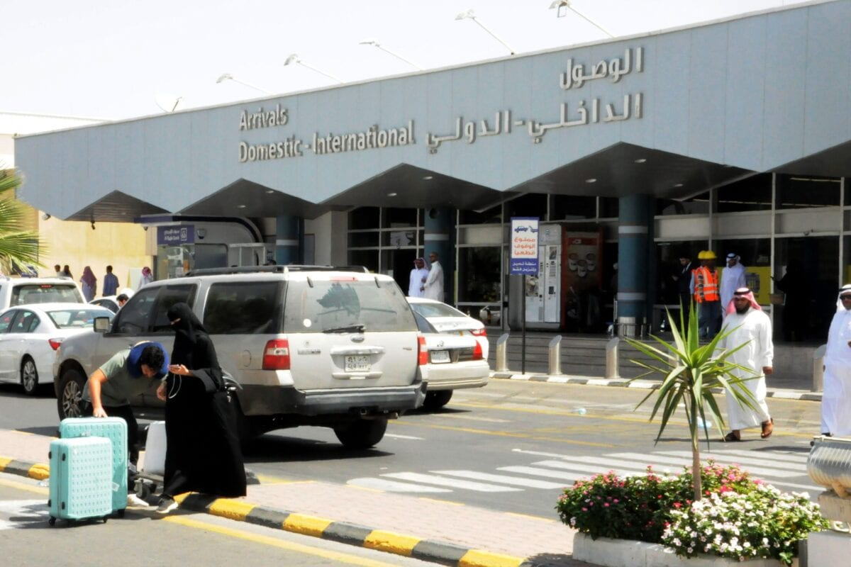 Travellers gather in front of the arrivals lounge at the Abha airport in the southern Saudi Arabian popular mountain resort of the same name, on 2 July 2019. [AFP via Getty Images]