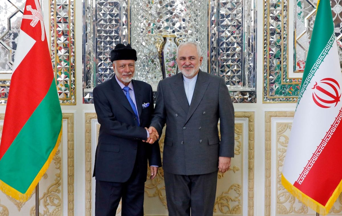 Iran's Foreign Minister Mohammad Javad Zarif (R) welcomes Oman's Minister of State for Foreign Affairs Yusuf bin Alawi bin Abdullah in Tehran on 2 December 2019. [STR/afp/AFP via Getty Images]