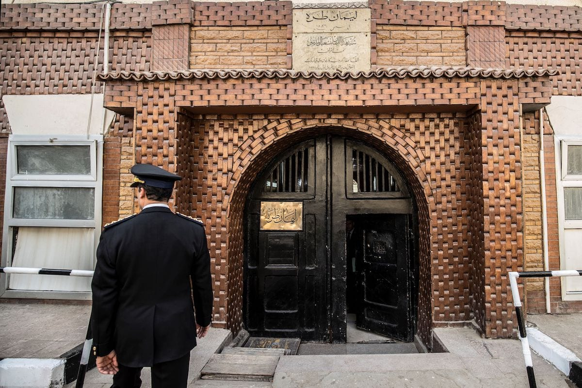 An Egyptian police officer enters the Tora prison in the Egyptian capital Cairo on 11 February 2020 [KHALED DESOUKI/AFP via Getty Images]