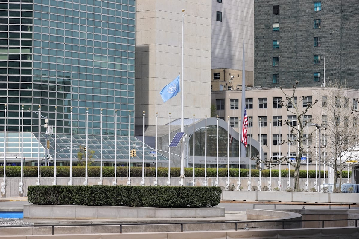 The flag of the United Nations flies at half mast at the UN Headquarters in New York City, New York, during an outbreak of the COVID-19 coronavirus, on 17 April 2020. [EuropaNewswire/Gado/Getty Images]