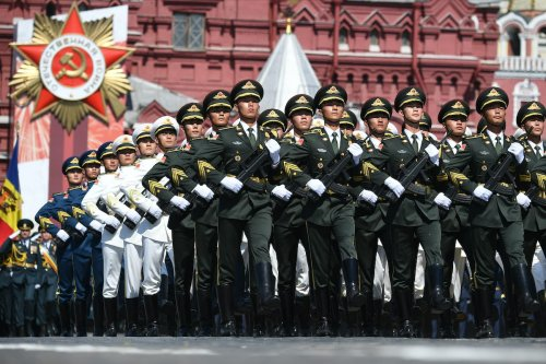 Servicemen of the Chinese Armed Forces march during a Victory Day military parade in Red Square marking the 75th anniversary of the victory in World War II, on 24 June 2020 in Moscow, Russia. [Ramil Sitdikov - Host Photo Agency via Getty Images]