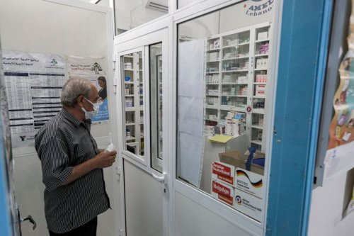 A man, mask-clad due to the COVID-19 coronavirus pandemic, waits to receive medication from the pharmacy of the Amel NGO in Lebanon's southern coastal city of Tyre on July 22, 2020 [JOSEPH EID/AFP via Getty Images]