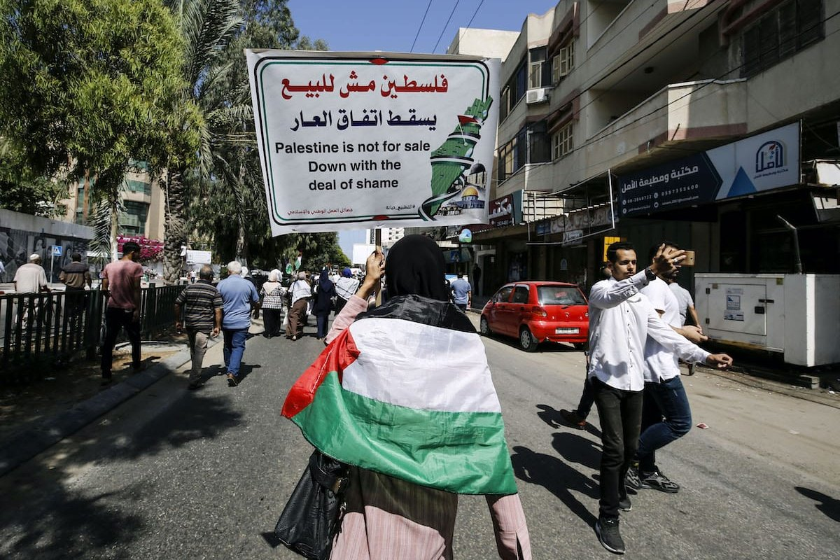 Palestinians shout slogans during a protest against the United Arab Emirates' deal with Israel to normalise relations, in Gaza City, on 19 August 2020. [MOHAMMED ABED/AFP via Getty Images]
