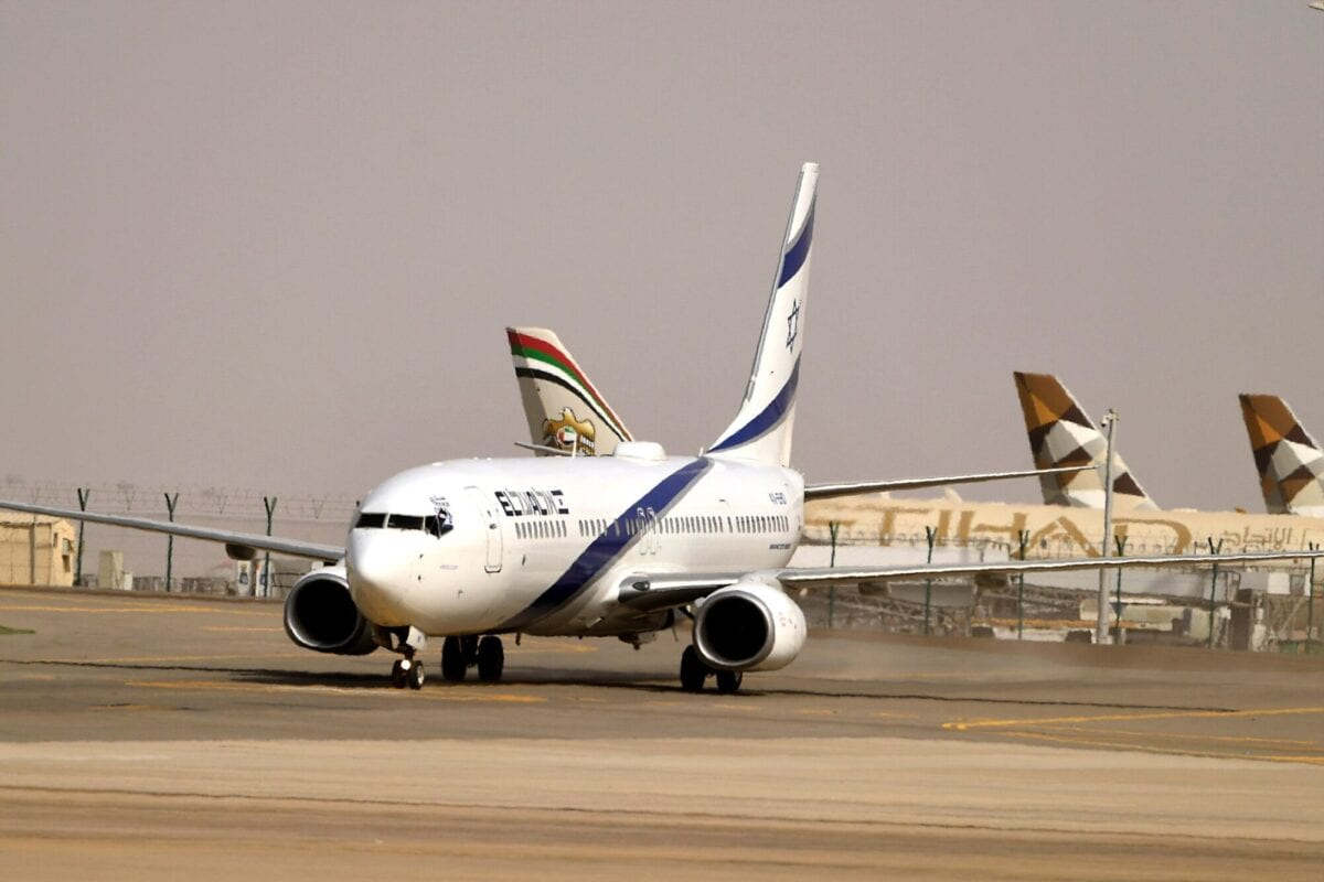 An air-plane of Israel's El Al is pictured at the tarmac of Abu Dhabi airport in the first-ever commercial flight from Israel to the UAE, on August 31, 2020 [KARIM SAHIB/AFP via Getty Images]