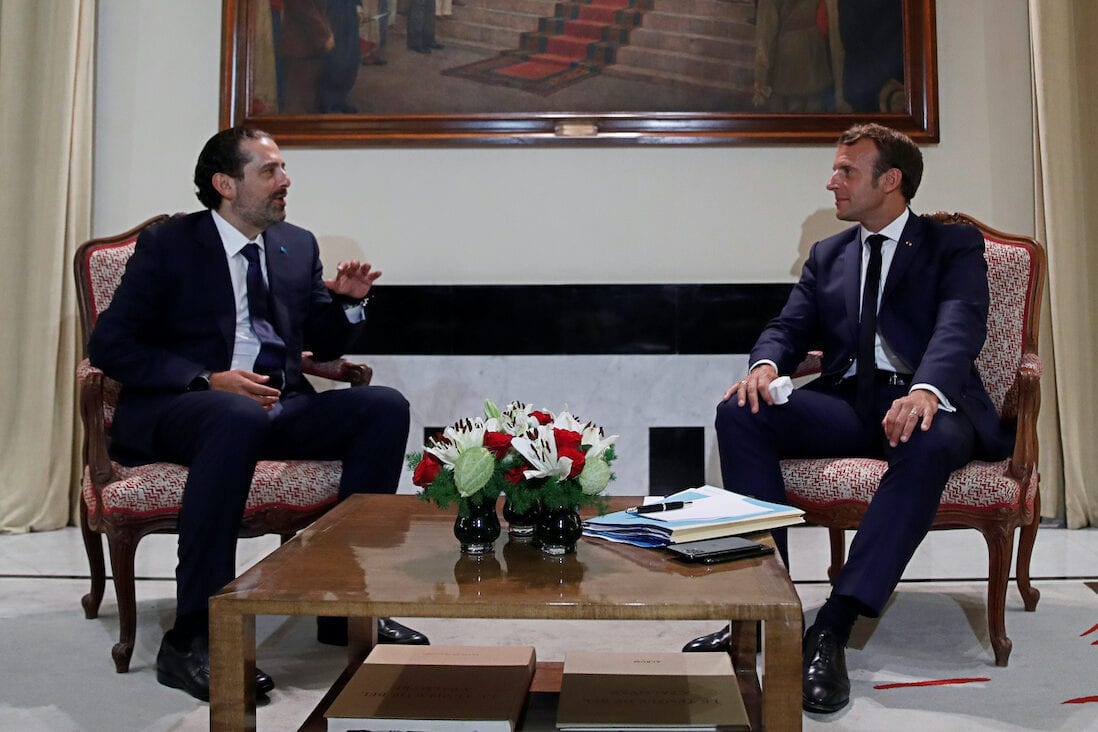 French President Emmanuel Macron meets former Lebanese Prime Minister Saad Hariri (L) at the Pine Residence, the official residence of the French ambassador to Lebanon, in Beirut, on 31 August 2020. [GONZALO FUENTES/POOL/AFP via Getty Images]