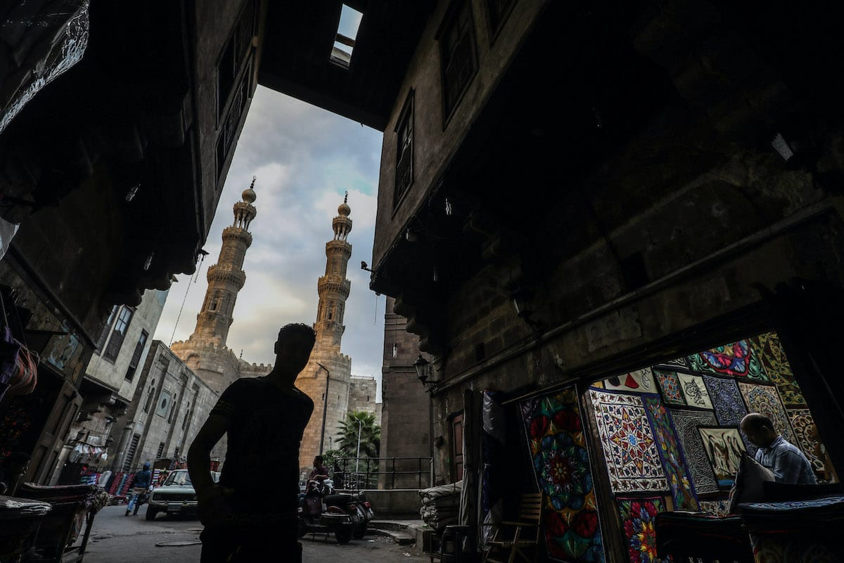 An Egyptian man walks past a shop in Khayamiya Street, or the Street of Tent-makers, in the old city of the Egyptian capital Cairo on September 11, 2020. [MOHAMED EL-SHAHED/AFP via Getty Images]