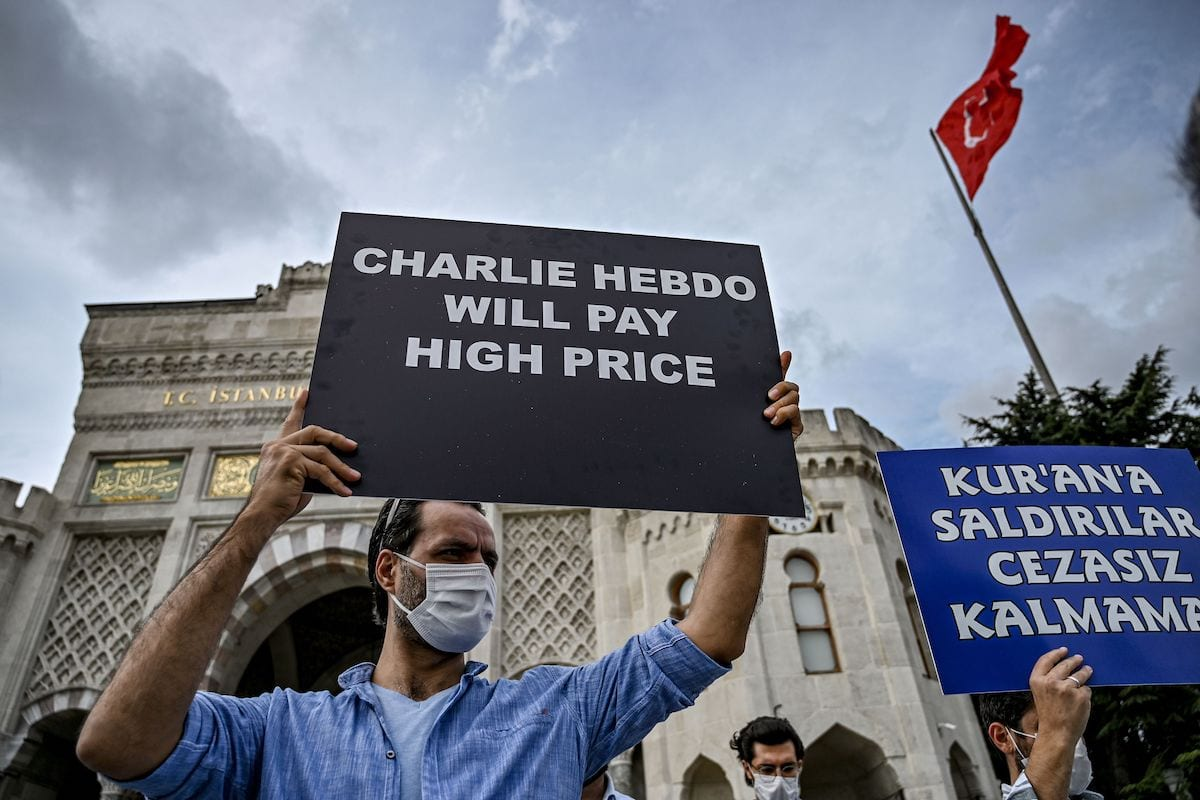 Protesters chant slogans and hold signs against France and the French President in Istanbul, on September 13, 2020, [OZAN KOSE/AFP via Getty Images]