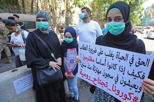 Relatives of inmates at Roumieh prison stage a demonstration outside the ministry of justice in the Lebanese capital Beirut on September 14, 2020, calling for a general amnesty and for the protection of prisoners following the spread of COVID-19 in the facility. [ANWAR AMRO/AFP via Getty Images]